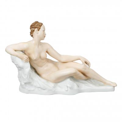 "Large porcelain figure ""Lying woman"""