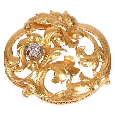 Gold brooch with a diamond