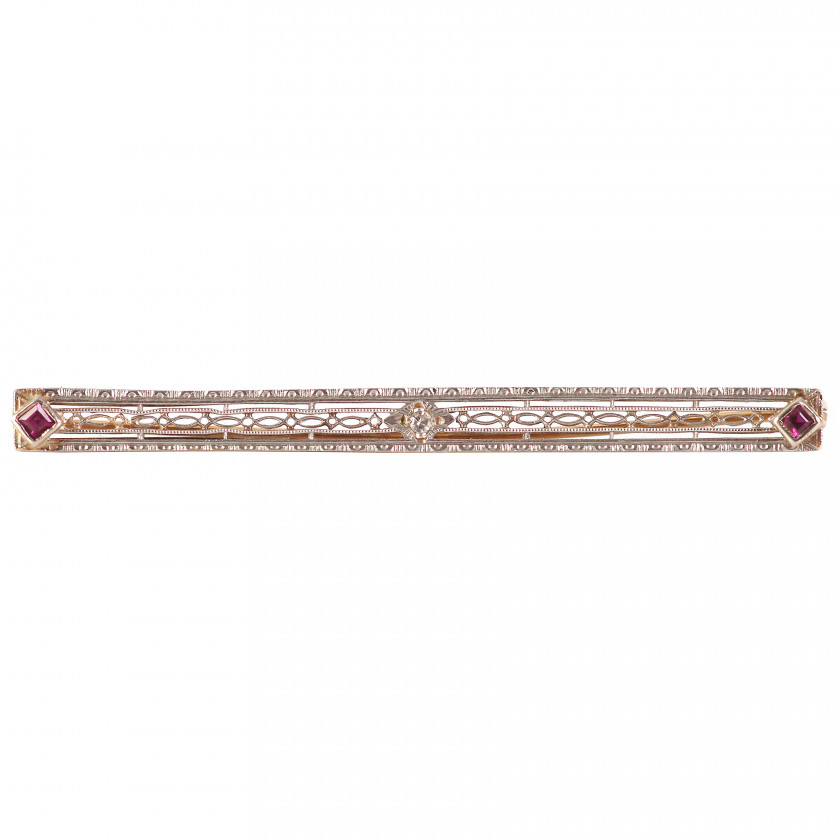 Gold brooch with a diamond and rubies