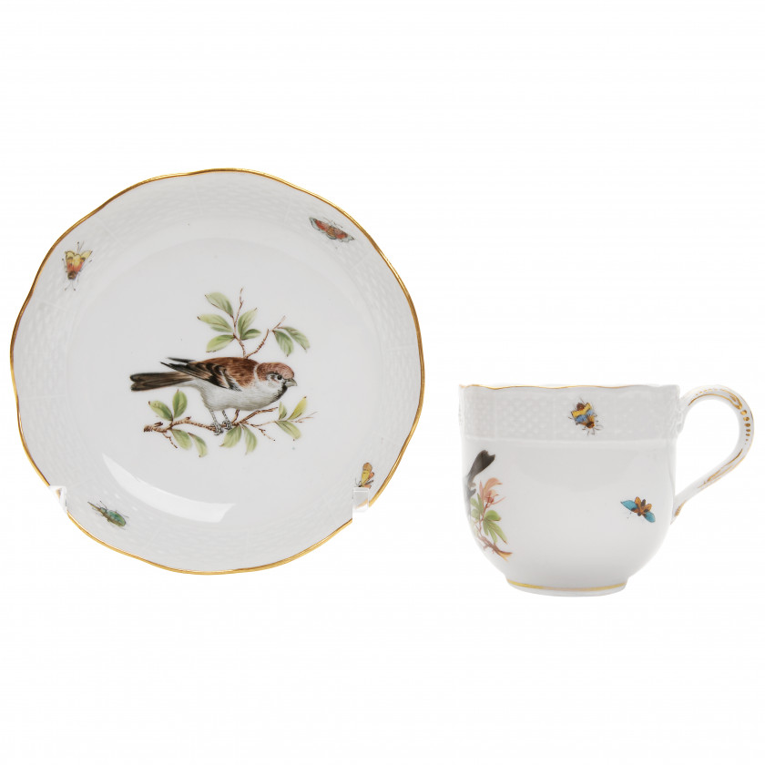 Porcelain tea cup and a saucer