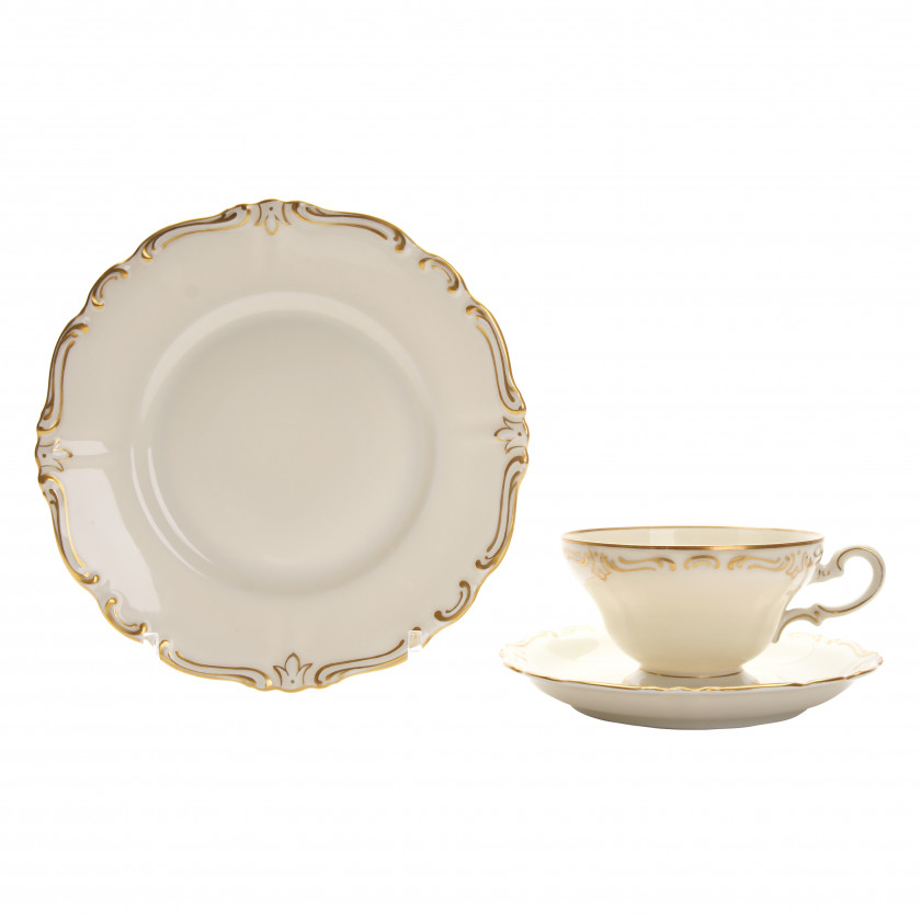 Porcelain tea cup with two saucers