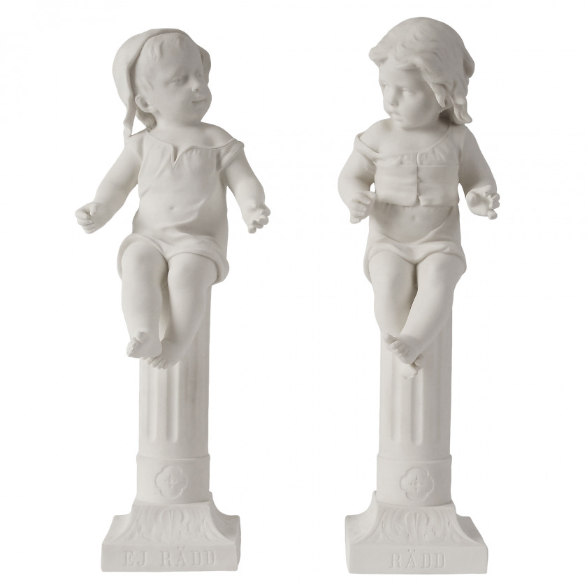 """A pair of biscuit figures """"Children on the columns"""""""