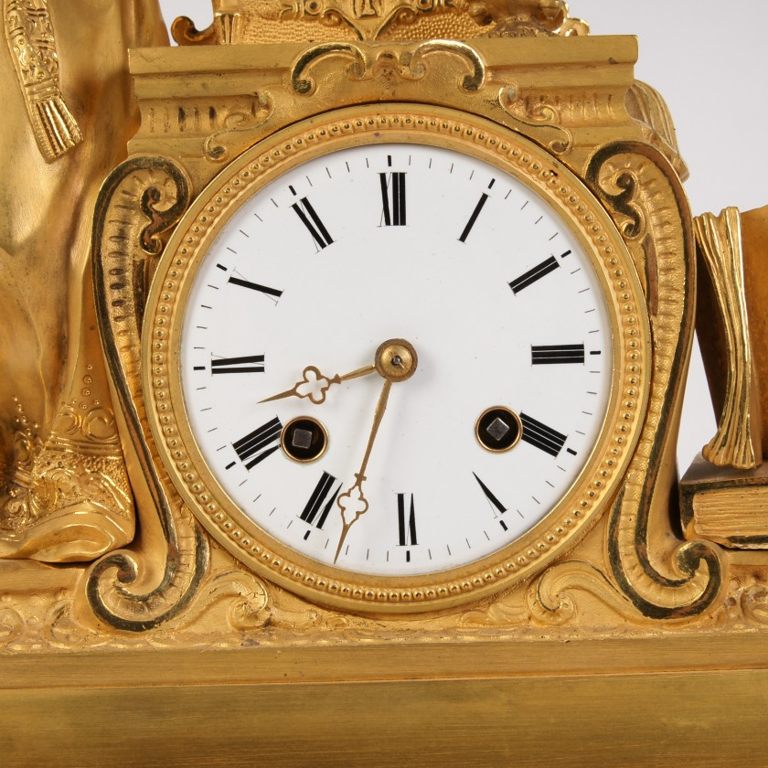 "Bronze clock with sculpture ""Lady next to casket"""