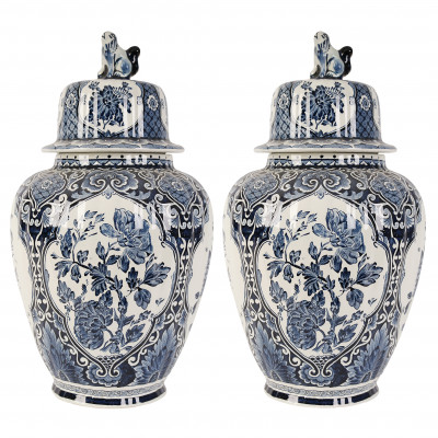 A pair of faience decorative vases