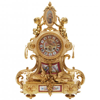 Bronze mantel clock with porcelain inserts