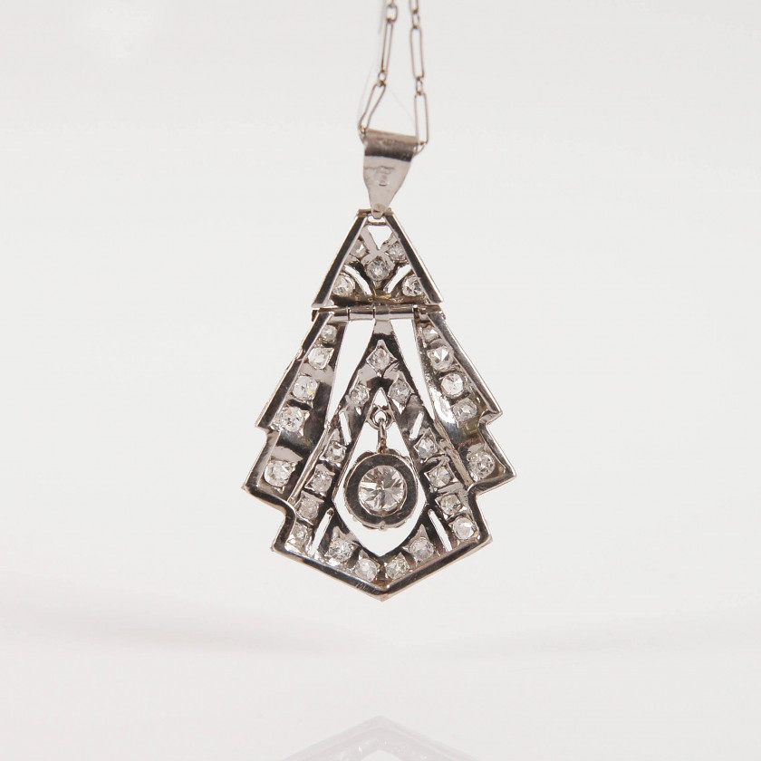 Platinum pendant with chain and diamonds