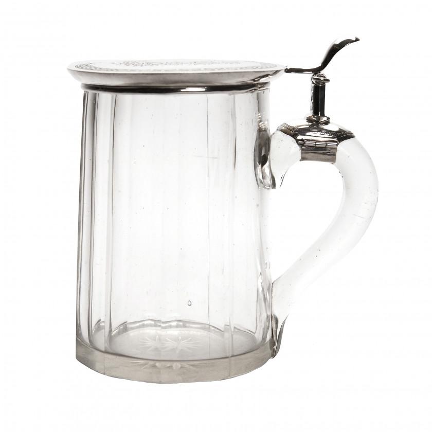 Glass beer mug with silver lid