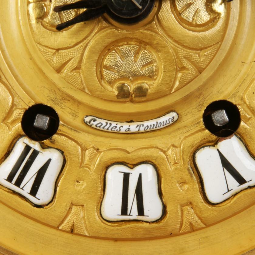 Bronze mantel clock with candlesticks