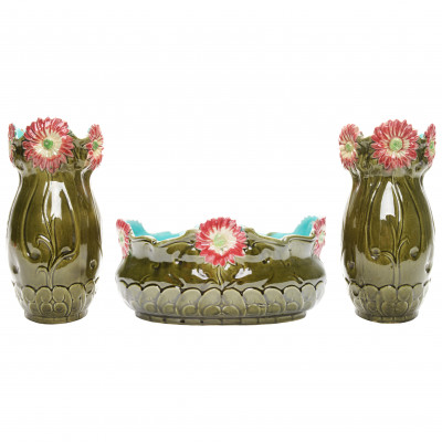 A pair of faience vases with a flower pot
