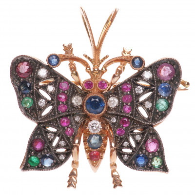 Gold brooch-pendant with precious stones