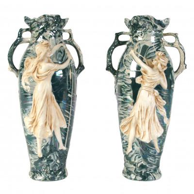 A pair of porcelain decorative vases