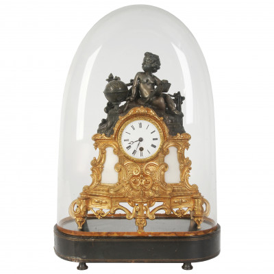 Mantel clock under glass dome