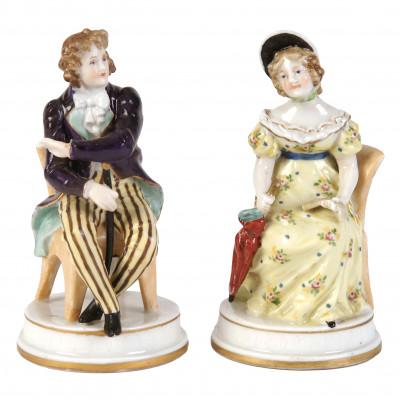 A pair of porcelain figures