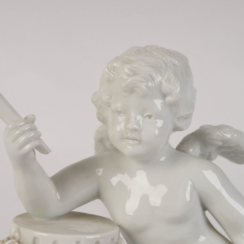 "Porcelain figure ""Cherub with torch"""