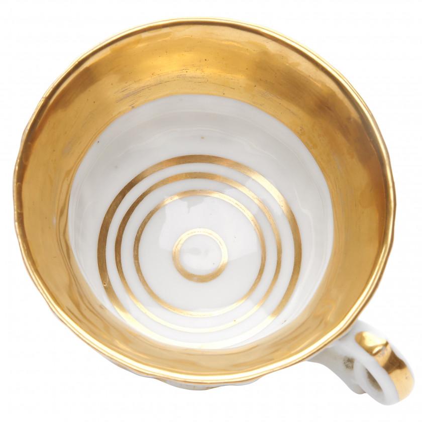 Porcelain tea cup and a saucer