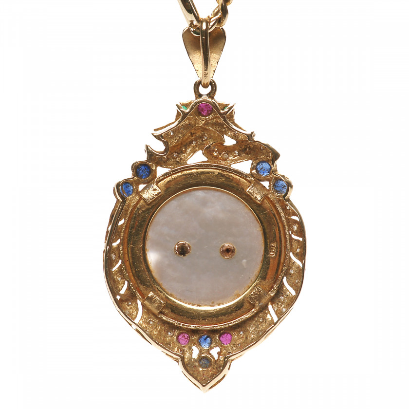 Gold pendant with precious stones