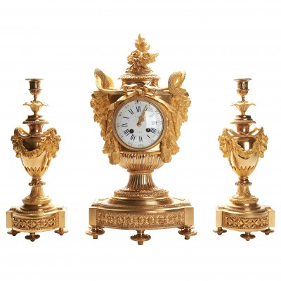 Bronze mantel clock and a pair of candlestick...