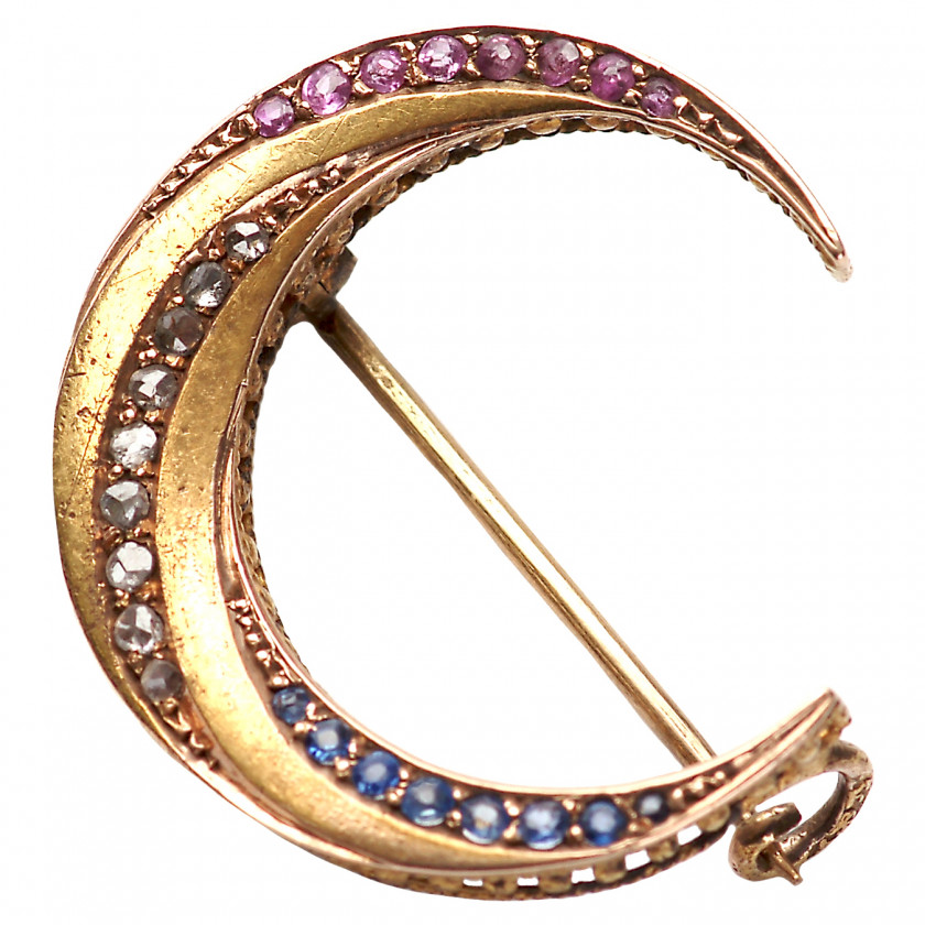 Gold brooch with precious stones
