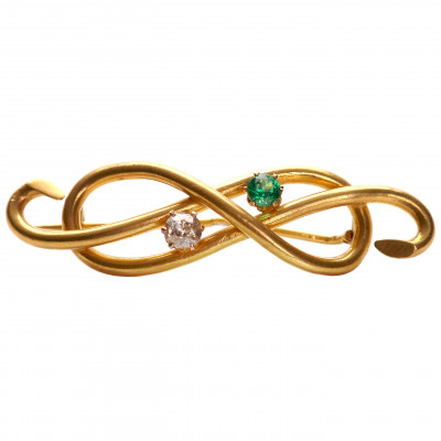 Gold brooch with diamond and emerald