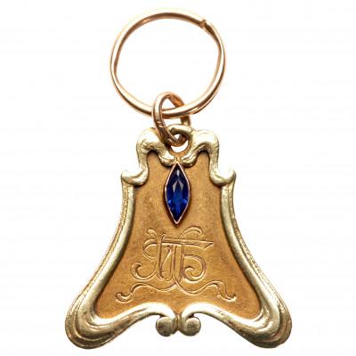 Zelta atslēgu ķēde ar safīru